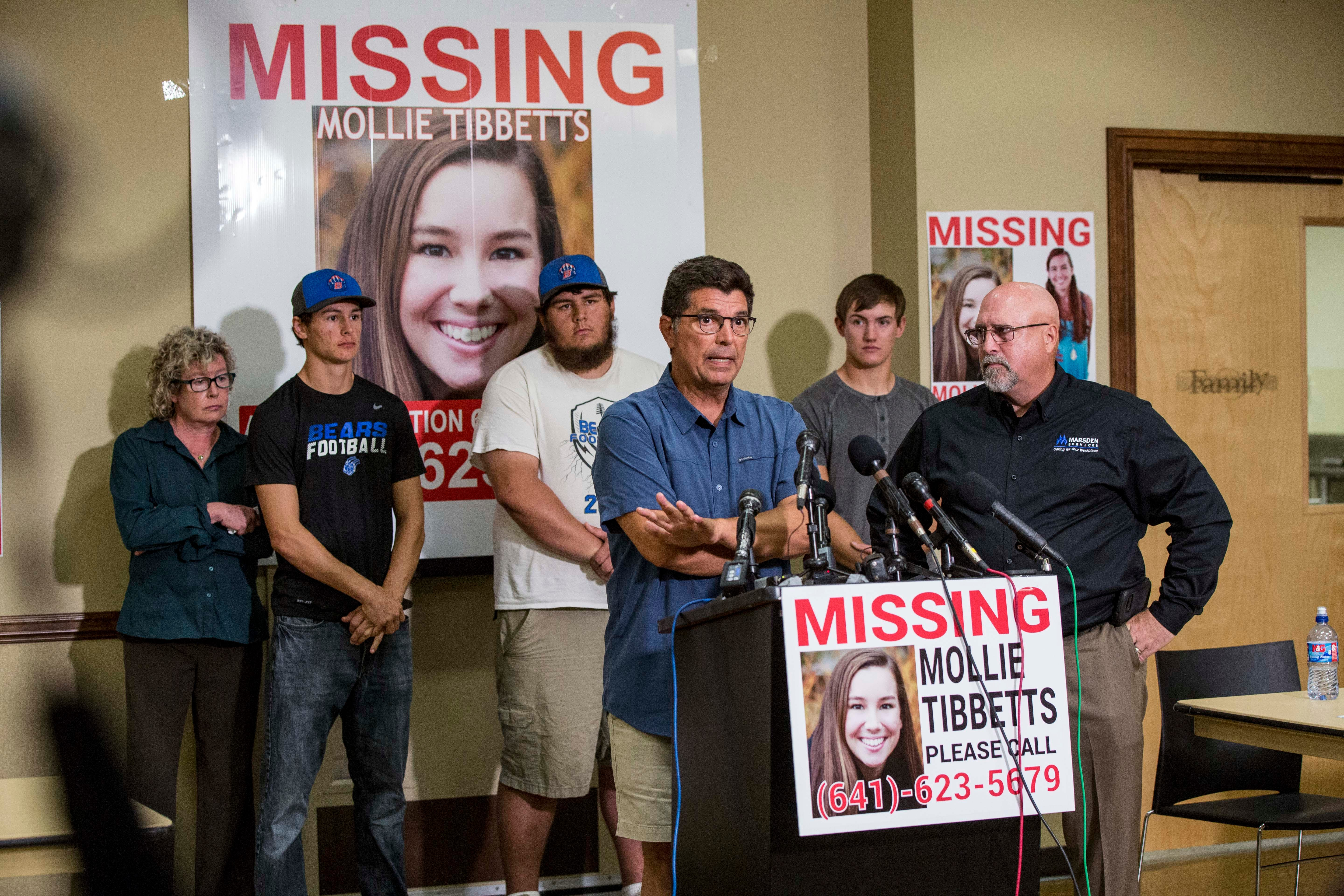 Rob Tibbetts answers questions during a press conference Aug. 2, 2018. Mollie's mom, brothers and boyfriend stand behind him.