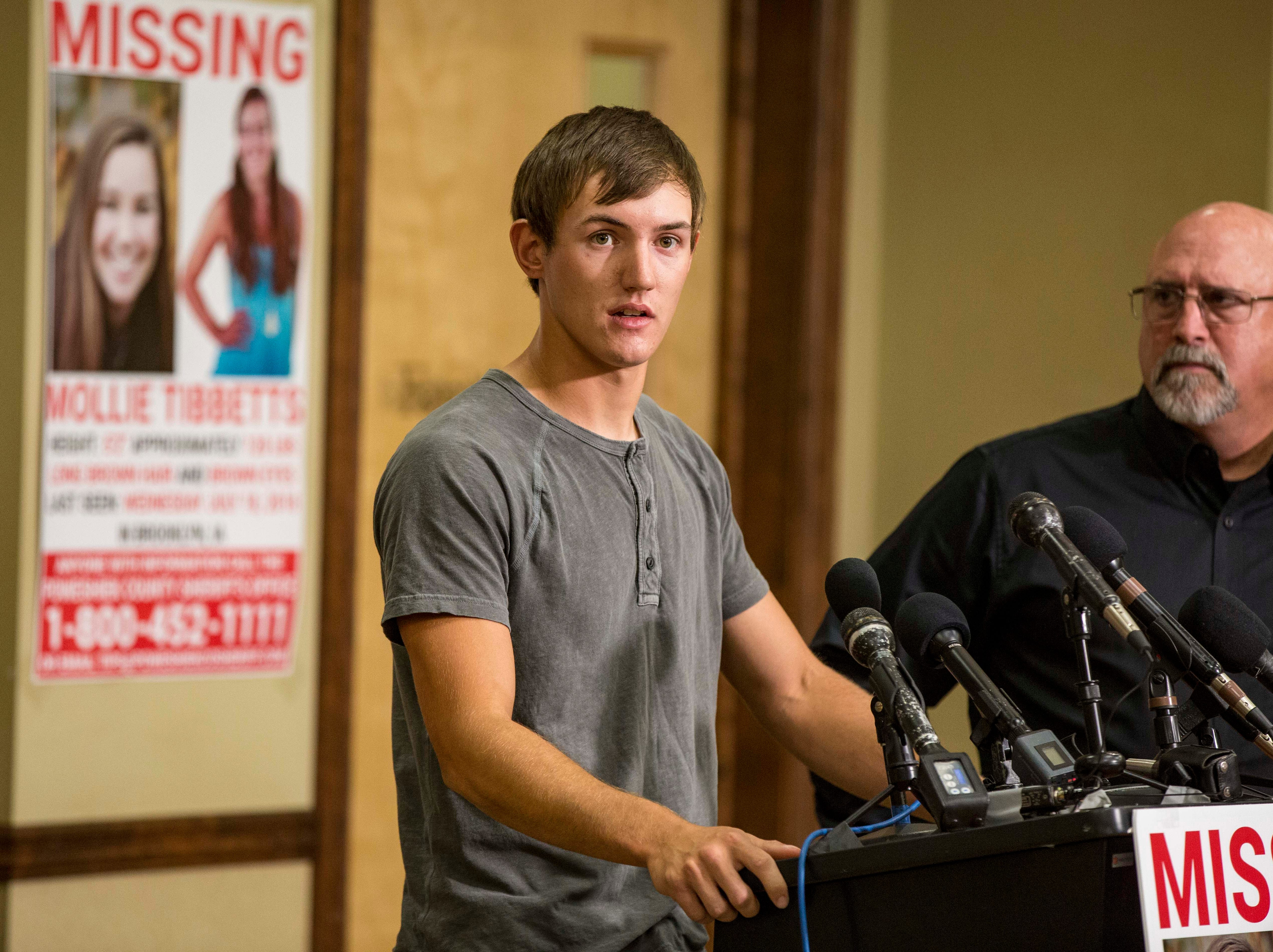 "Dalton Jack, Mollie's boyfriend, answers questions during a press conference announcing a ""Bring Mollie Tibbetts Home Safe Reward Fund"" Thursday, Aug. 2, 2018, in Brooklyn, Iowa."