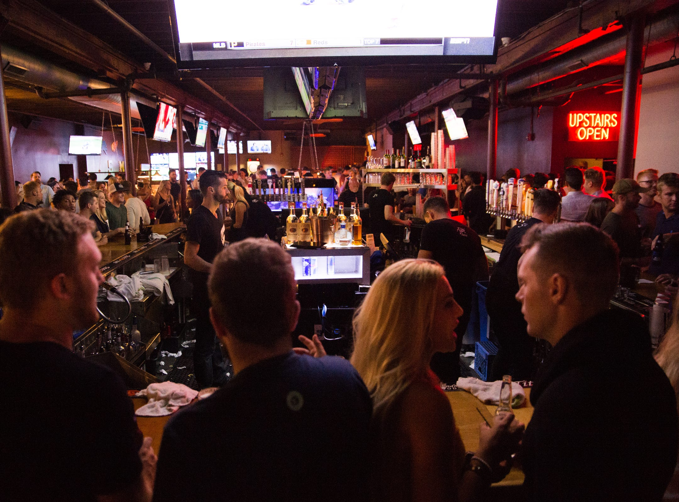 Guests surround the bar at Fifth Avenue nightclub in Royal Oak on Friday, July 20, 2018.