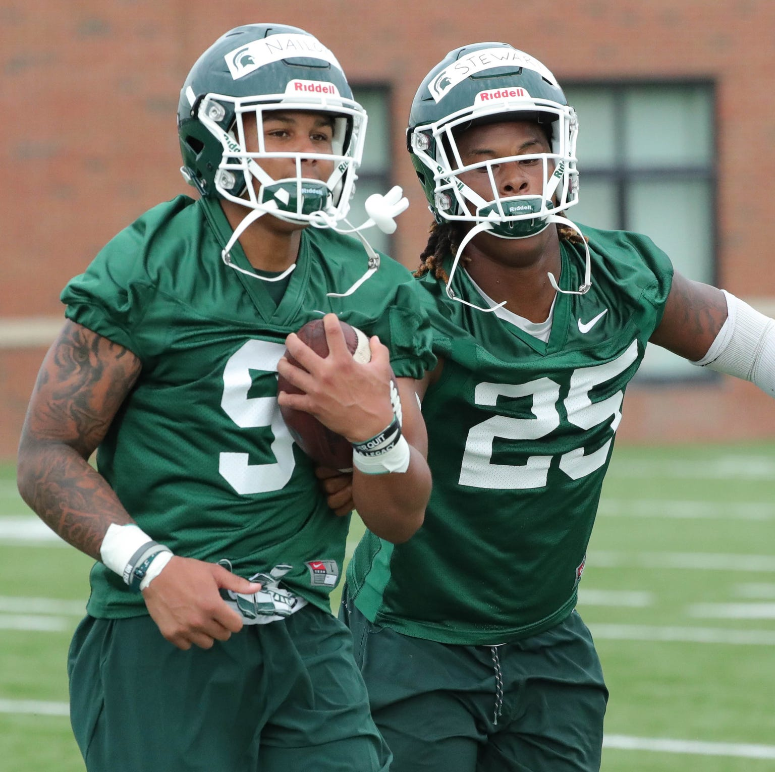 Michigan State receivers Jalen Nailor, left, and...