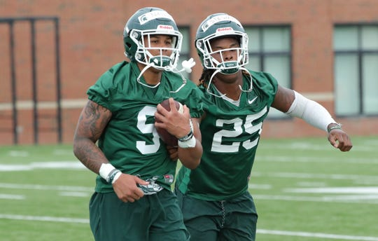 Michigan State receivers Jalen Nailor, left, and Darrell Stewart Jr. work on ball security during practice on Thursday, August 2, 2018, in East Lansing.