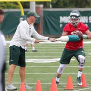 QB Rocky Lombardi goes through drills during practice Thursday in East Lansing.