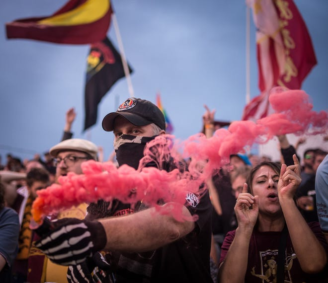 Christopher Dorman of Grosse Pointe Park fires off a smoke bomb during Detroit City FC's match against Kalamazoo FC at Keyworth Stadium in Hamtramck, June 23, 2018.