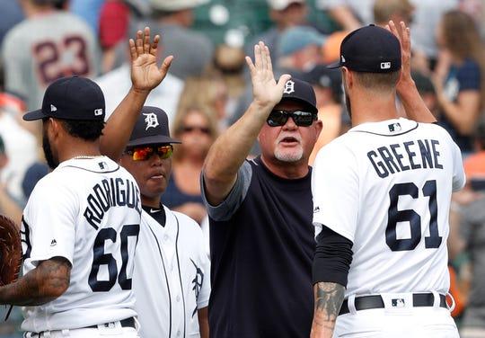 Tigers manager Ron Gardenhire celebrates with pitcher Shane Greene after the Tigers' 7-4 win over the Reds on Wednesday, Aug. 1, 2018, at Comerica Park.