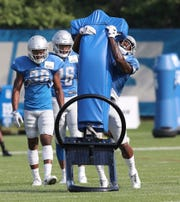 Lions cornerback Nevin Lawson hits a tackling dummy during practice during training camp on Thursday, Aug. 2, 2018, in Allen Park.
