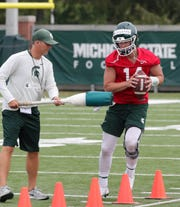 Michigan State quarterback Brian Lewerke goes through drills during practice last Thursday.