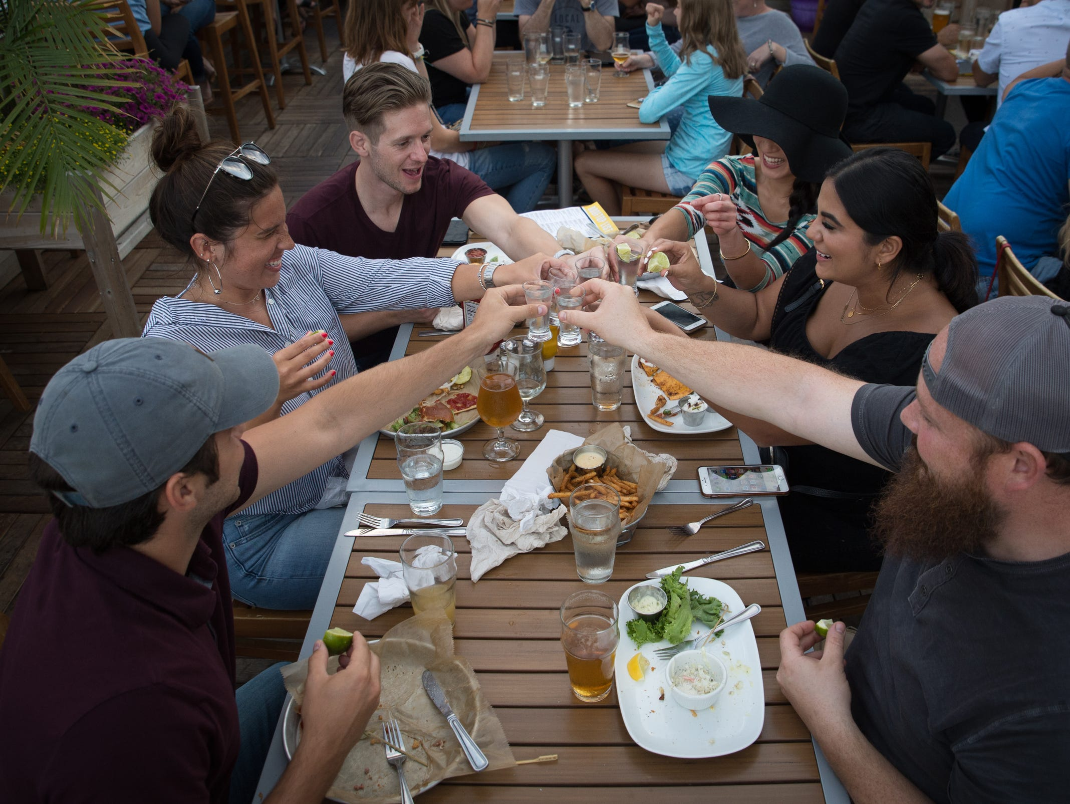 Jerome Rogers of Clinton Township, Cody Maccagnone of Clawson, Jonathan Bennett of Royal Oak, Olivia Ray of Royal Oak, Roya Yodhes and Nick Yodhes, both of Harrison Township, toast at HopCat in Royal Oak on Friday, July 20, 2018.