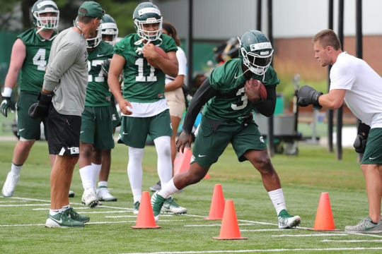 MSU running back LJ Scott goes through drills during practice Thursday, Aug. 2, 2018, at the John and Becky Duffey practice field in East Lansing.