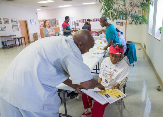 Duane Clark of Detroit and Corell Jones of Detroit role play a door-knocking scenario during a canvasser training by MOSES Action at the Chapel Hill Baptist Church in Detroit on Aug. 2, 2018.