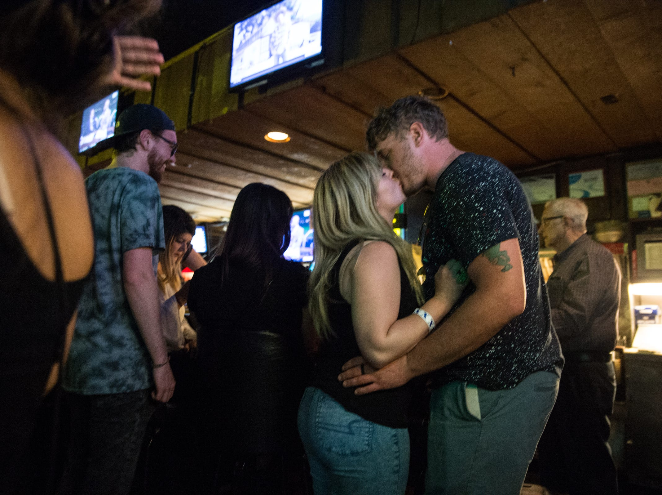A couple kisses at Sneakers Pub in Ferndale on Friday, July 20, 2018.