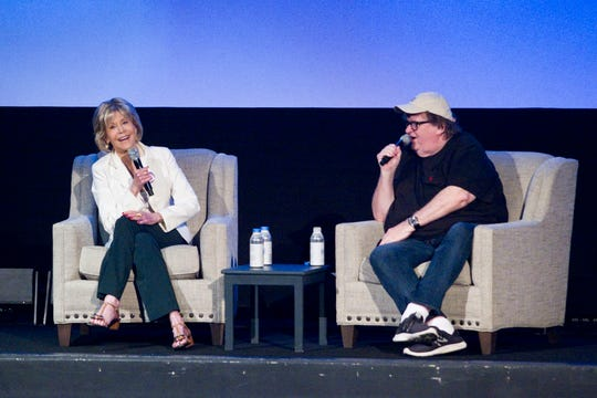 "Actress Jane Fonda and director Michael Moore speak during the panel, ""One-on-One With Jane Fonda,"" at the State Theatre during the Traverse City Film Festival Wednesday, Aug. 1, 2018, in Traverse City, Mich."
