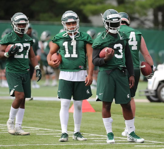 Michigan State running backs Weston Bridges, Connor Heyward and LJ Scott go through drills during practice on Thursday, August 2, 2018, in East Lansing.