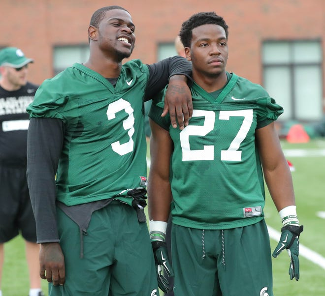 Michigan State running backs LJ Scott, left, and Weston Bridges before practice on Thursday, Aug. 2, 2018, in East Lansing.