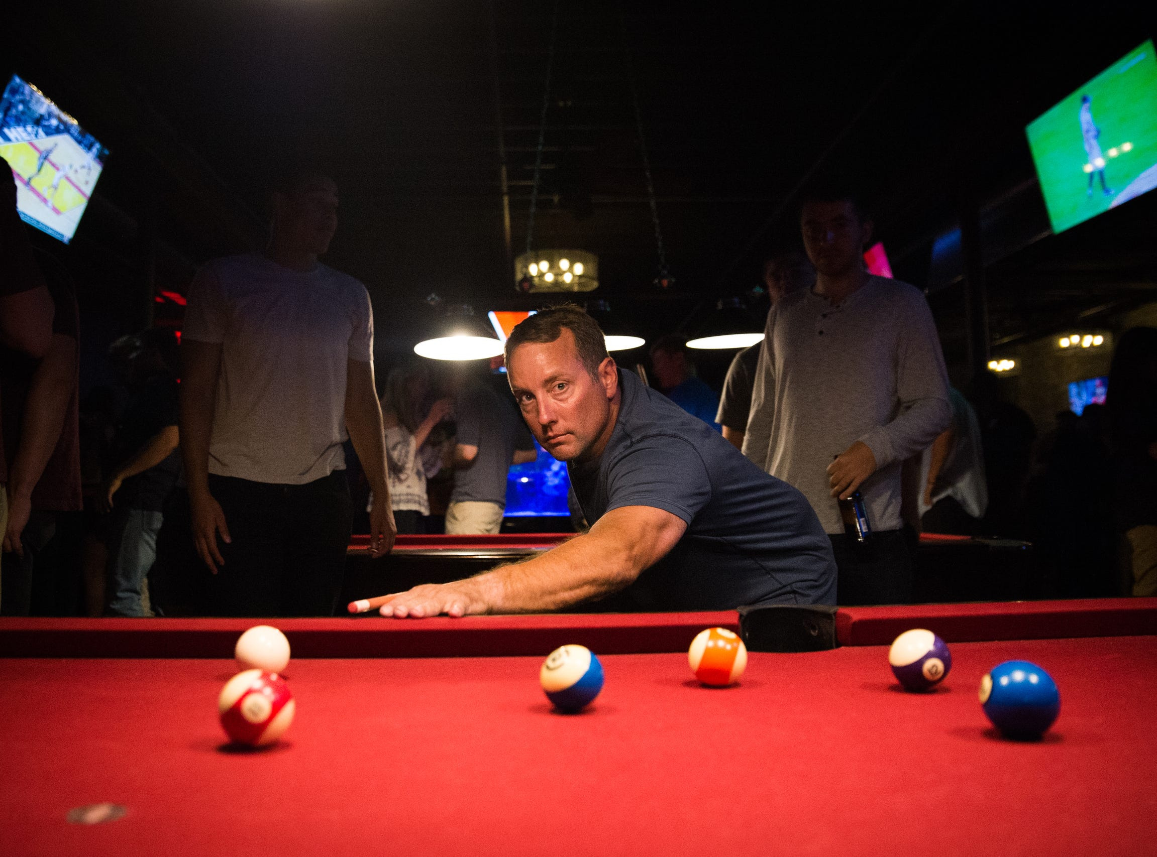 Dan Johnson of New Baltimore plays pool at Fifth Avenue nightclub in Royal Oak on Friday, July 20, 2018.
