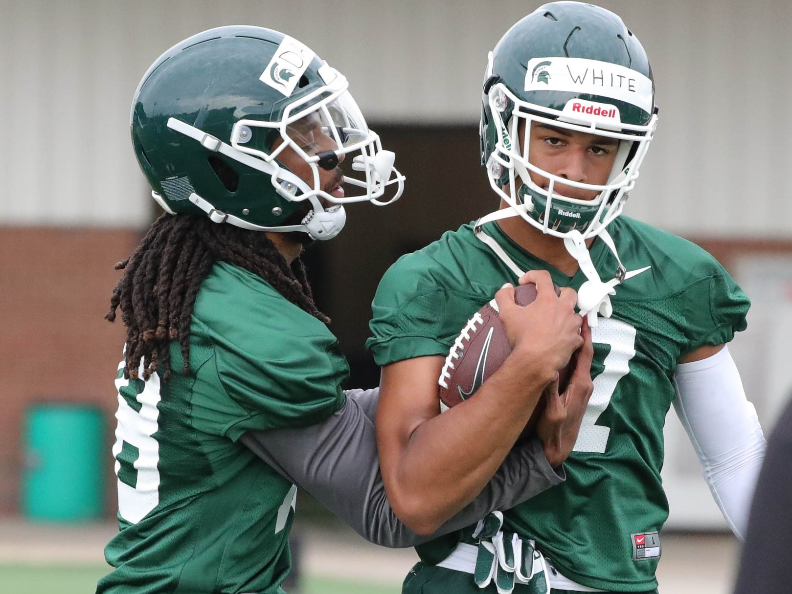 Michigan State receivers Felton Davis III and Cody White work on ball security during practice on Thursday, August 2, 2018, in East Lansing.