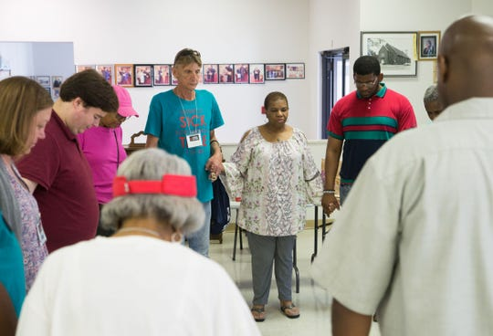 MOSES Action volunteer canvassers participate in a prayer circle before canvassing in Detroit on Aug. 2, 2018.