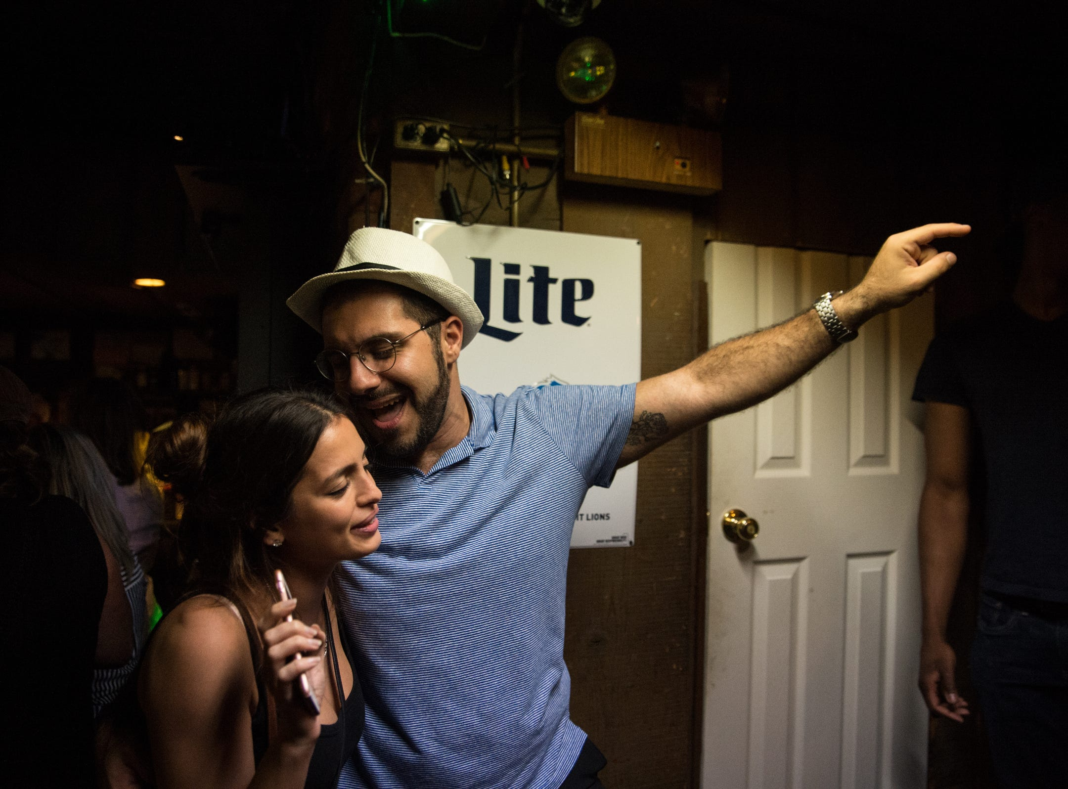 Yafa Davydova and Nadeem Kandalaft, both of Royal Oak, sing along to karaoke at Sneakers' Pub in Ferndale on Friday, July 20, 2018.