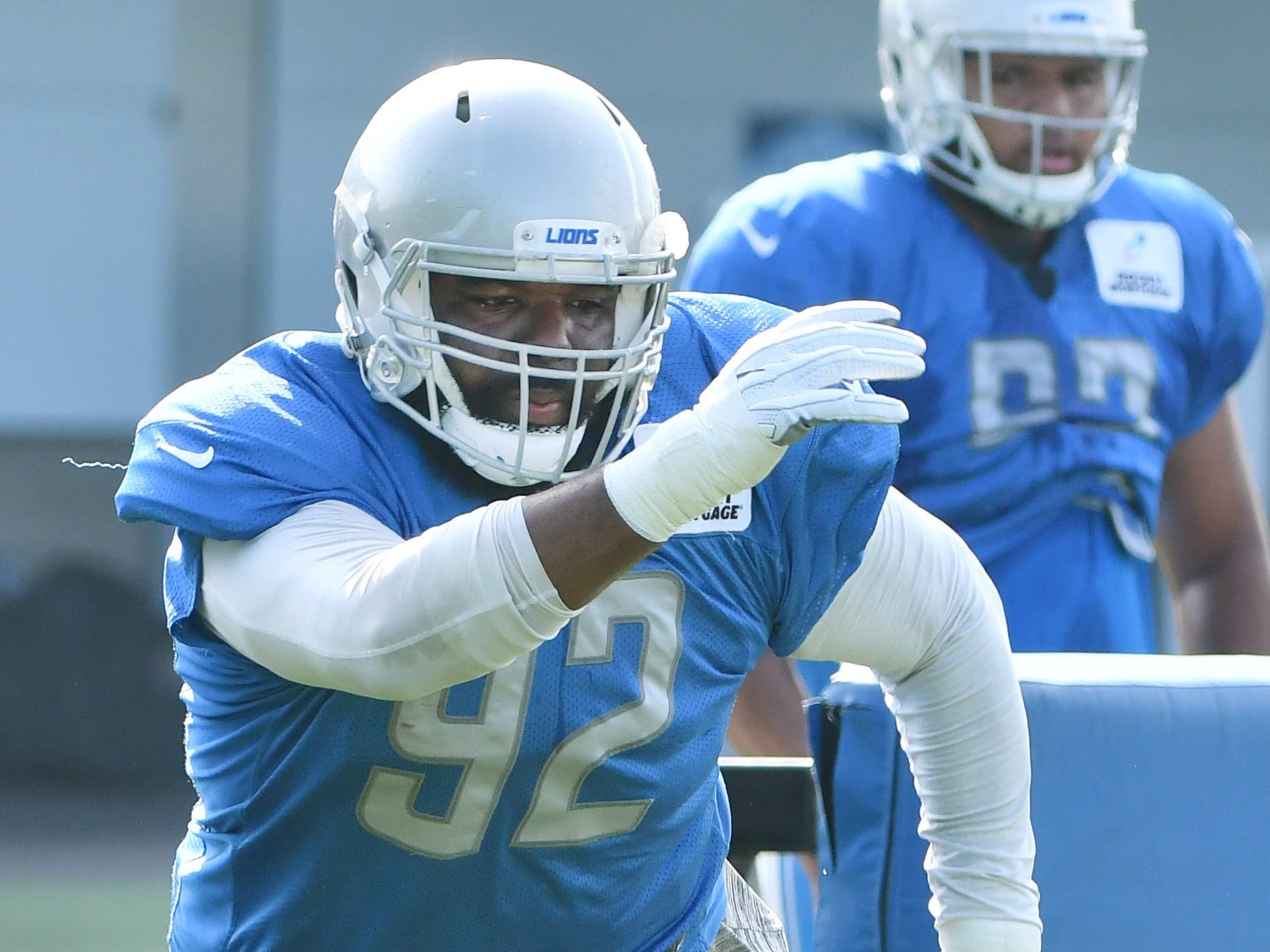 Lions defensive tackle Sylvester Williams works around the pylons.