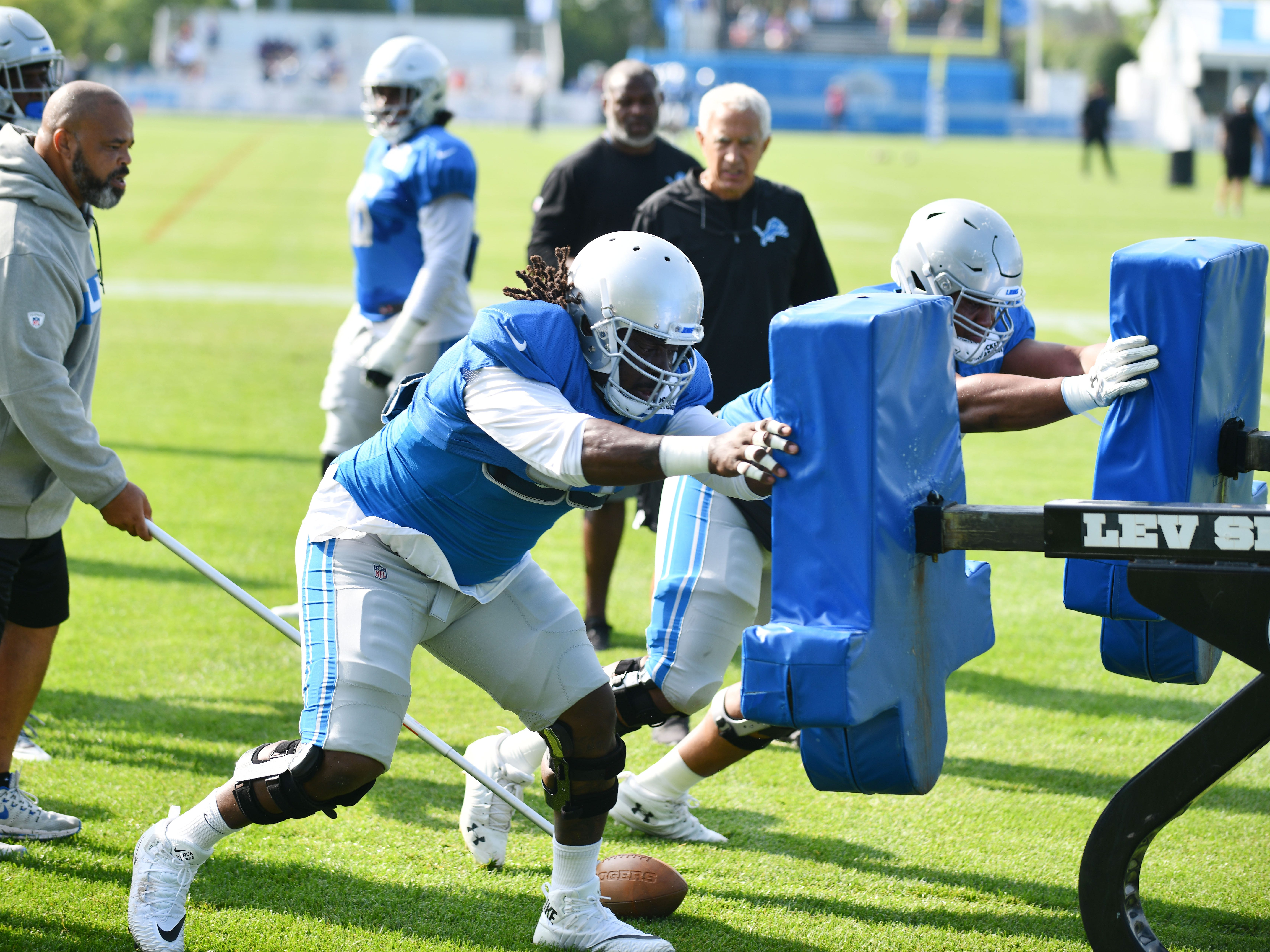 Lions defensive tackles Ricky Jean Francois and Jeremiah Ledbetter hit the sled during drills.