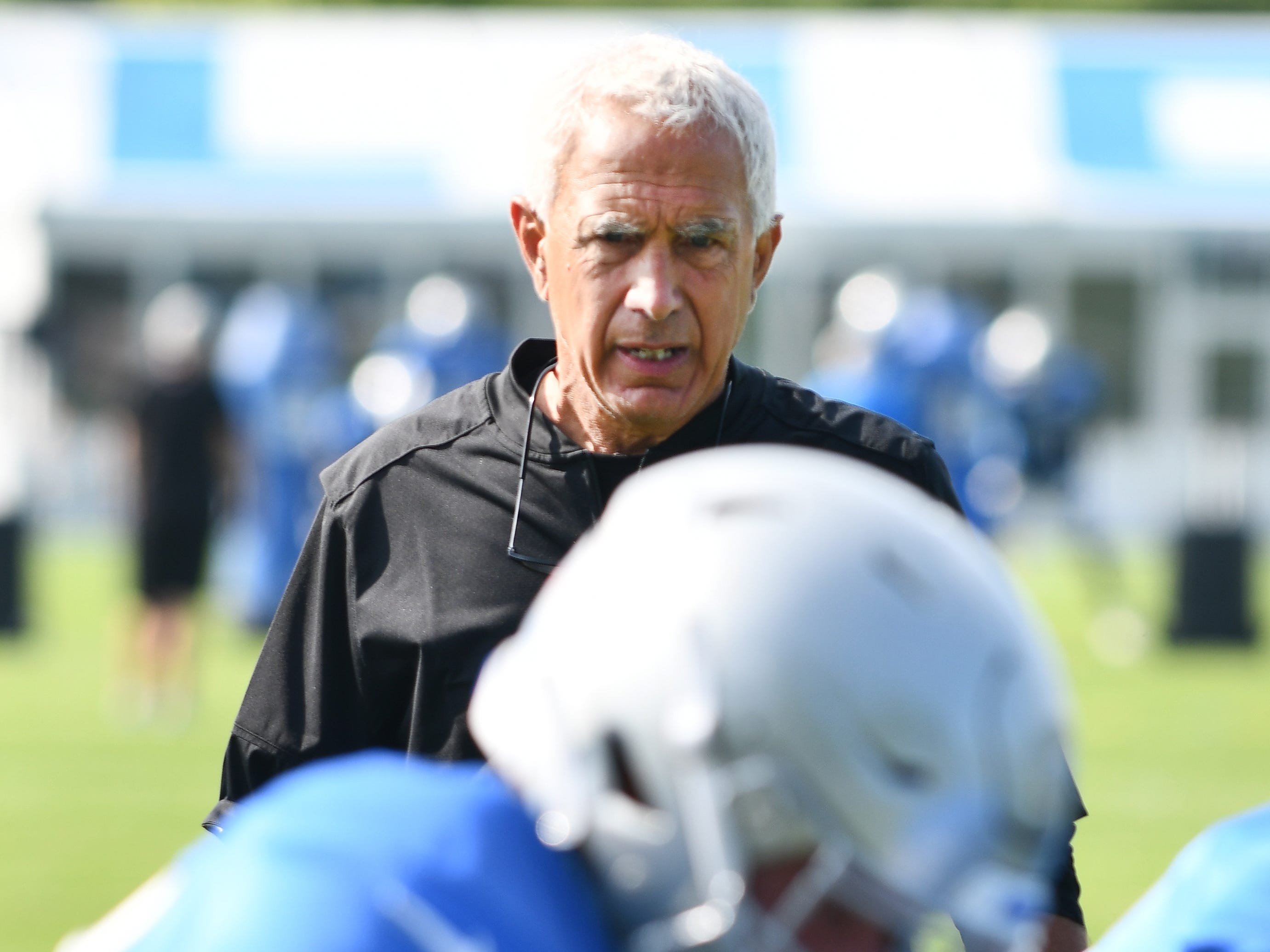 Lions defensive coordinator Paul Pasqualoni watches practice.