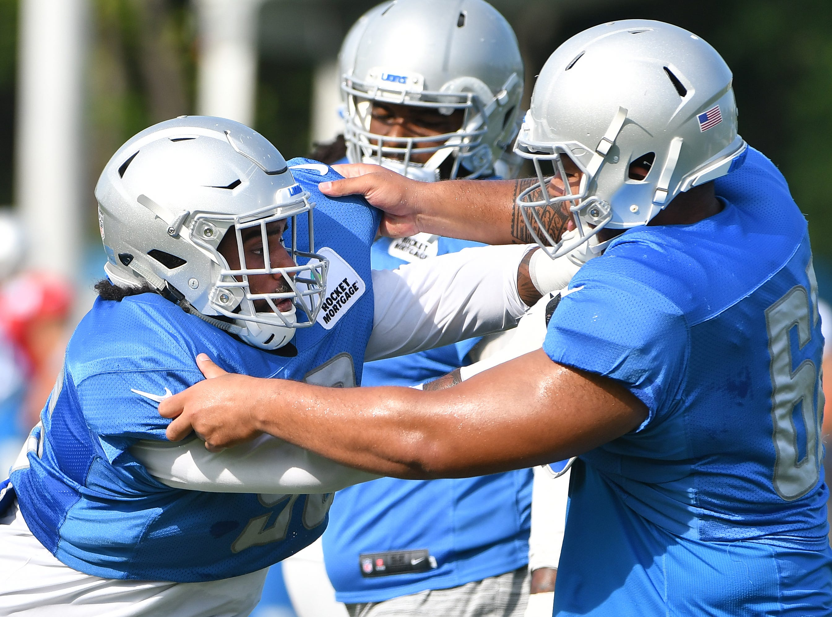 Lions defensive lineman JoJo Wicker and defensive tackle Josh Fatu work during drills.