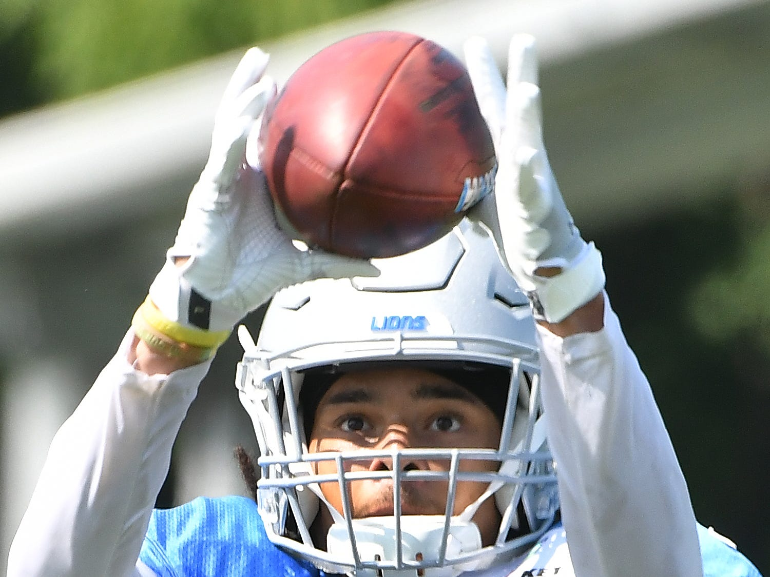 Lions cornerback Mike Ford works with the passing machine at after practice in Allen Park.