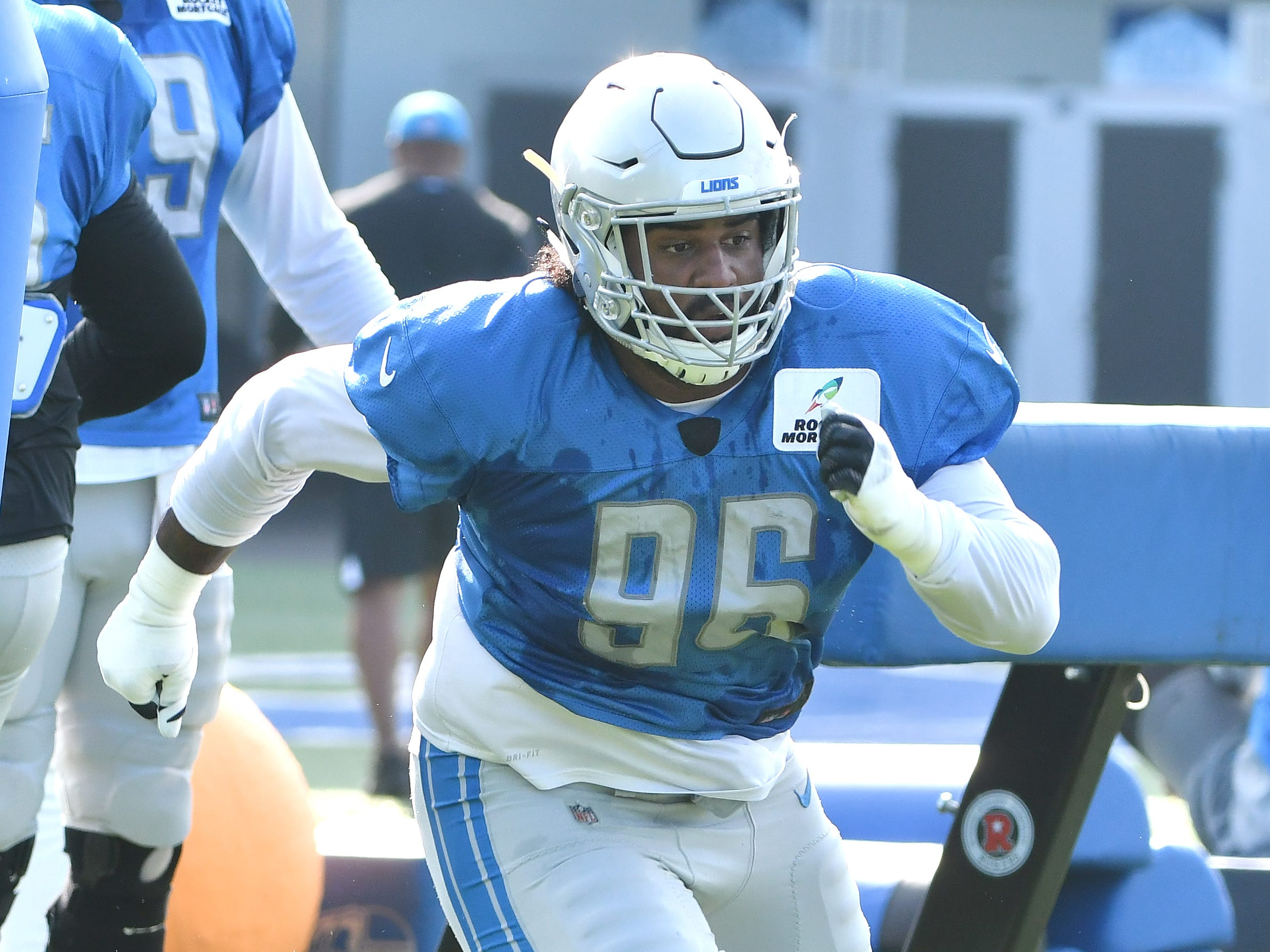 Lions defensive lineman JoJo Wicker works around the pylons.
