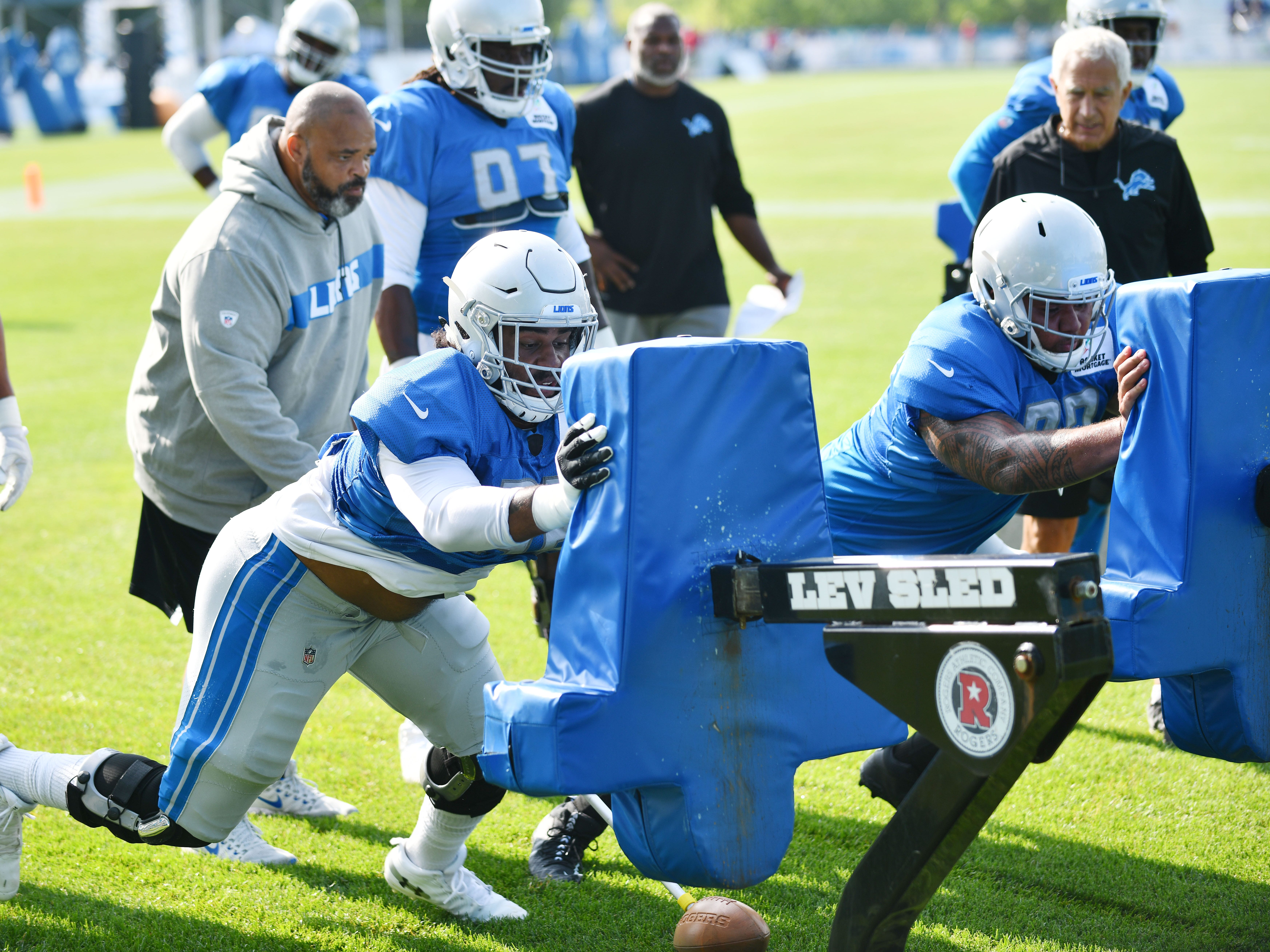 Lions defensive tackles JoJo Wicker and Josh Fatu hit the sled during drills.