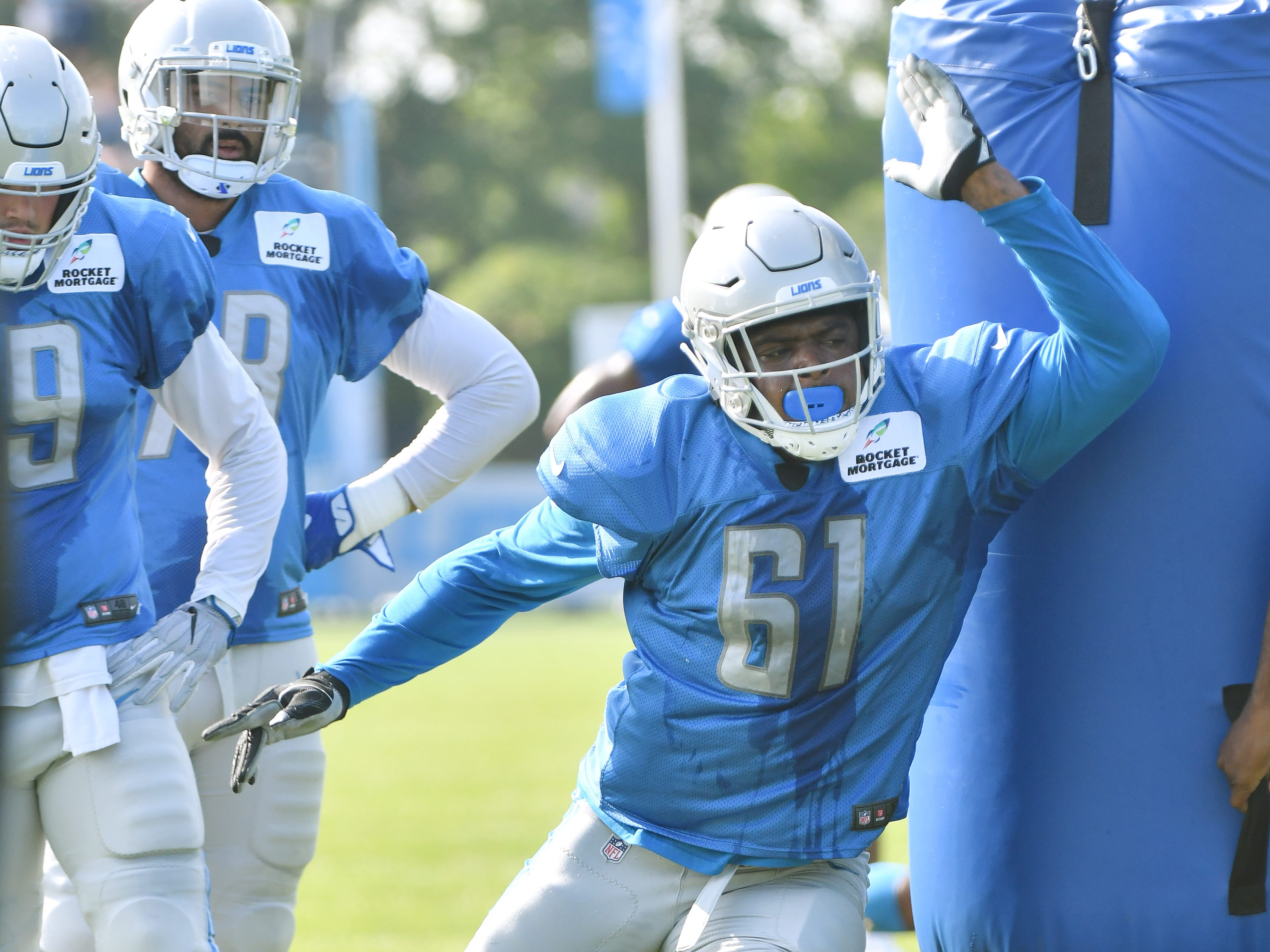 Lions defensive end Kerry Hyder Jr. works around the pylons.