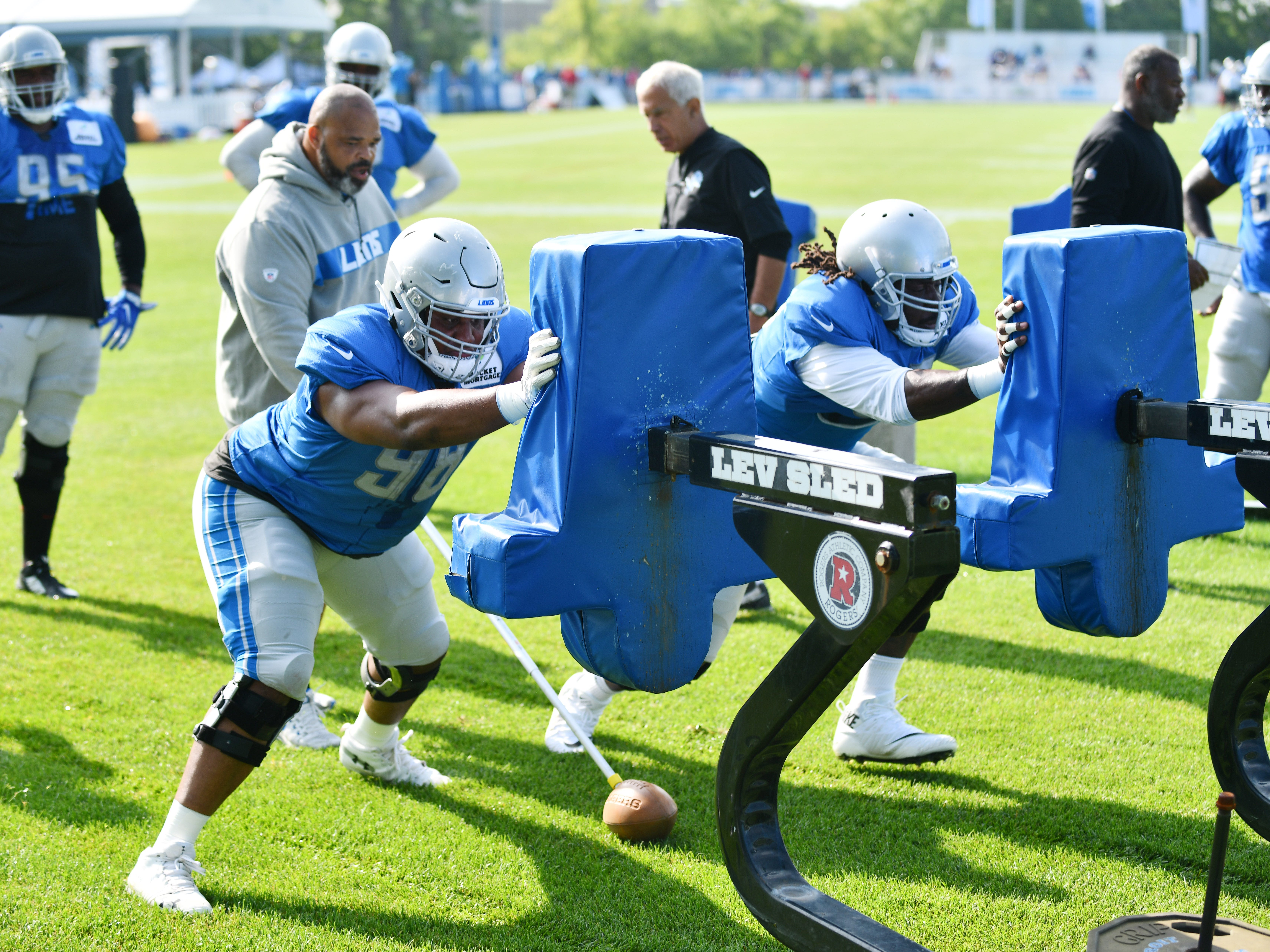 Lions defensive tackles Jeremiah Ledbetter and Ricky Jean Francois hit the sled during drills.