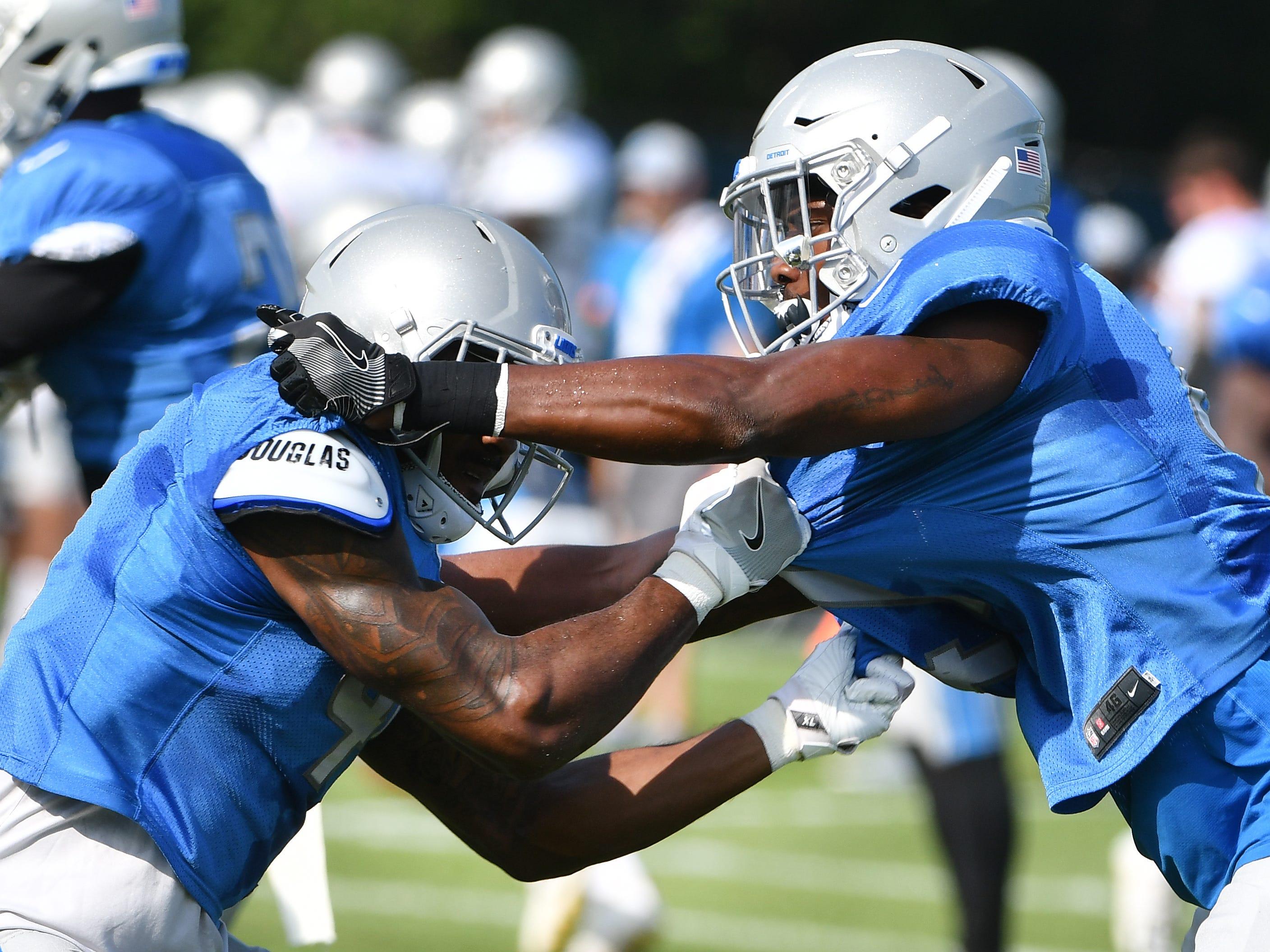 Lions safety Rolan Milligan and defensive back Tracy Walker work during drills.
