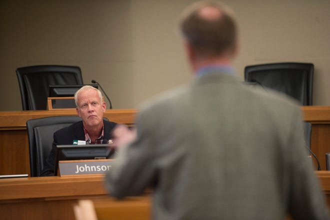 Thornton Water Project Director Mark Koleber answers questions from Larimer County Commissioner Steve Johnson during a hearing for the proposed Thornton water pipeline on Wednesday, August 1, 2018. Commissioners have decided to table the hearing until December to allow for public representation in the project along with expert consultation.