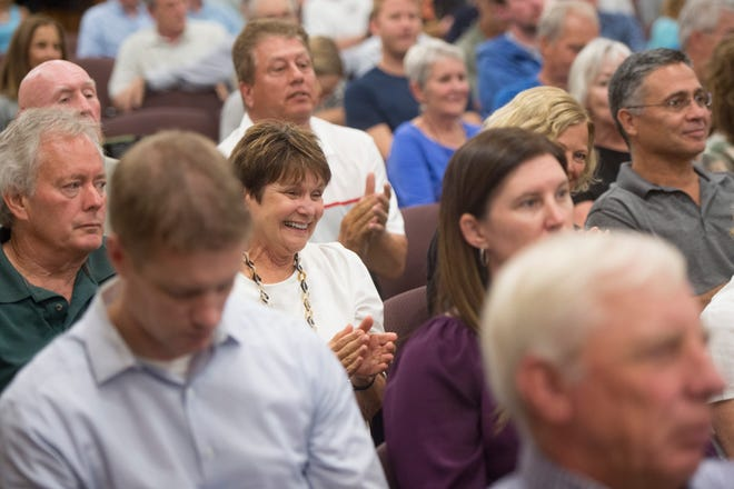 People react to comments from Larimer County Commissioners during a hearing for the proposed Thornton water pipeline on Wednesday, August 1, 2018. Commissioners have decided to table the hearing until December to allow for public representation in the project along with expert consultation.