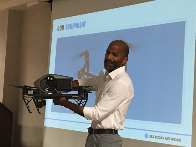 News-Press journalist Kinfay Moroti showcases the new drone at a USA TODAY NETWORK presentation.