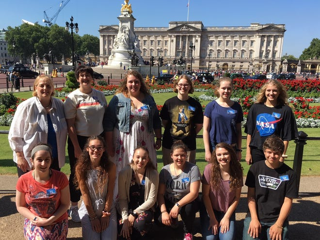 Oconto Falls and Abrams representatives on the 2018 Wisconsin Ambassadors of Music tour of Europe June 27-July 12 pose for a picture of Buckingham Palace in London. From left, front row: Haley Schwantes, Cedar Olson, Lauryn Slade, Kaylin Nickels, Isabella Rennie, and Garrett Wons; back row Oconto Falls High School choral director and 2018 WAM Choir director Amy Thiel, Paige Stapleton, Emma Bliskey, Allison Luebke, Catelyn Kramer, and Grace Williams.