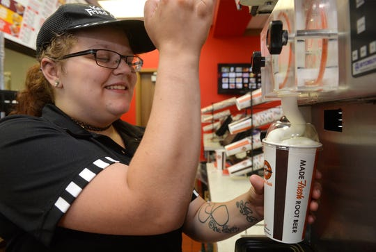 Desiree Walker makes a root beer float on Wednesday afternoon in the kitchen of the A&W All American Food restaurant on Central Avenue. Monday from 2-8 p.m., A&W will be handing out free root beer floats for national root beer float day and is encouraging patrons to donate Disabled American Veterans.