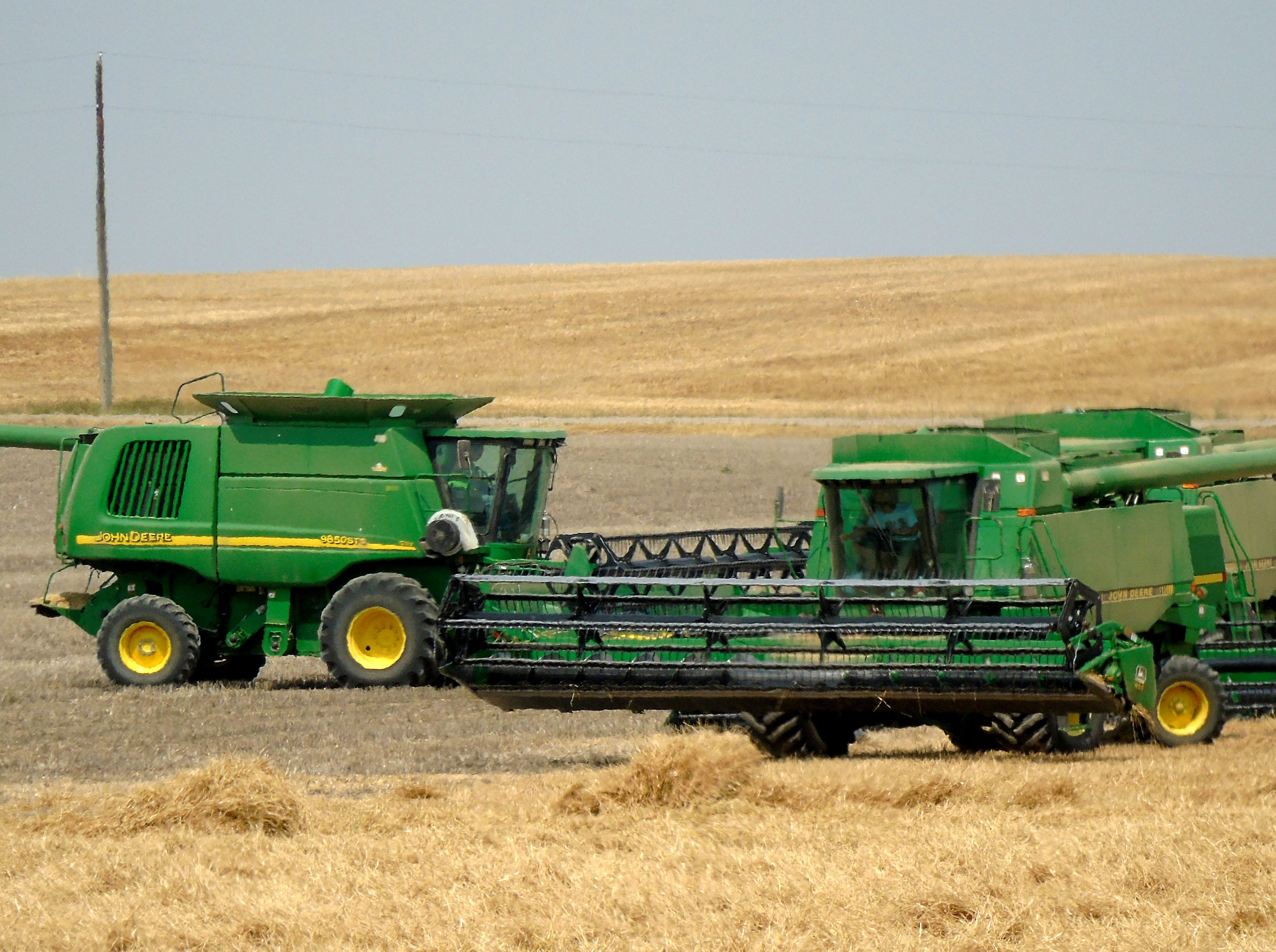 Combines on the move near Carter.