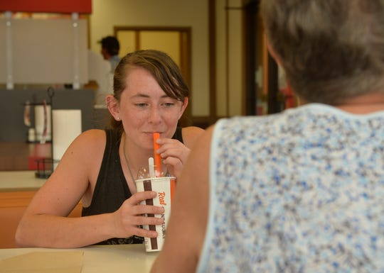 Jessica Swartz enjoys a root beer float from A&W on Wednesday afternoon.