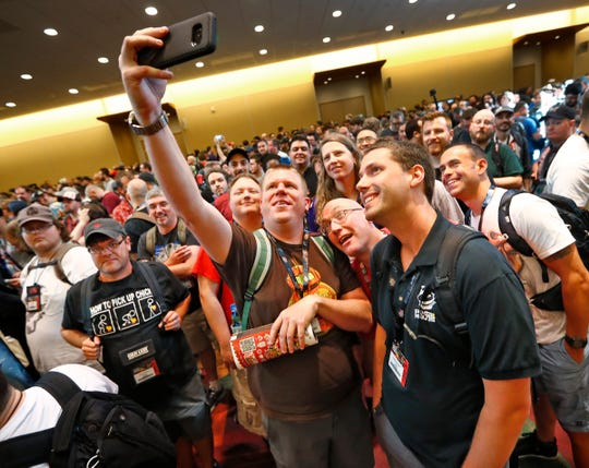 People take a group selfie while waiting for the doors to open on opening day of Gen Con 2018, at the Indiana Convention Center, Thursday, Aug. 2, 2018.
