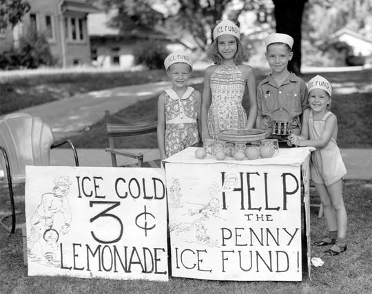 Eagerly awaiting thirsty customers on July 29, 1939 in front of the Barney home at 3058 E. Fall Creek Blvd. were (left to right) Nan Barney, Jessie Brayton, Johnny Brayton and Judy Barney. Revenues from sales at their curbside stand were donated to the Penny Ice Fund, sponsored by The Indianapolis Star and the Salvation Army during the summer months from 1931 to 1957.