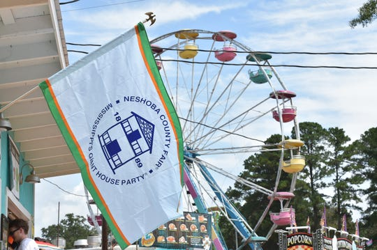 The Neshoba County Fair flag waves in front of the famous fair grounds during the 129th fair. Thursday, Aug. 2, 2018.