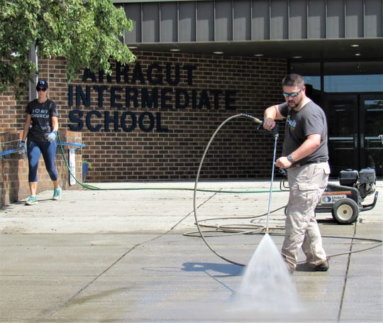 Members of One Life Church volunteered to pitch-in by power-washing the front entrance and tending to the grounds.