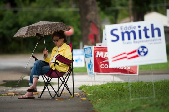 Marty Kenney sits outside Christenberry Elementary on election day in Knox County Thursday, Aug. 2, 2018.