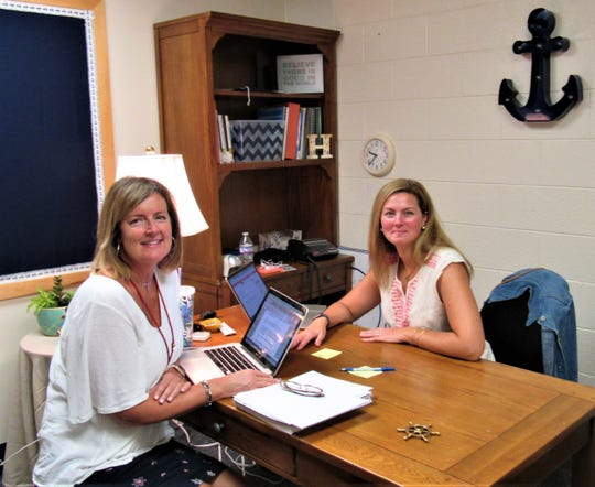 Assistant principals Amy Schumpert and Stacy Hilliard prepare for the new school year at Farragut Intermediate School. July 2018.