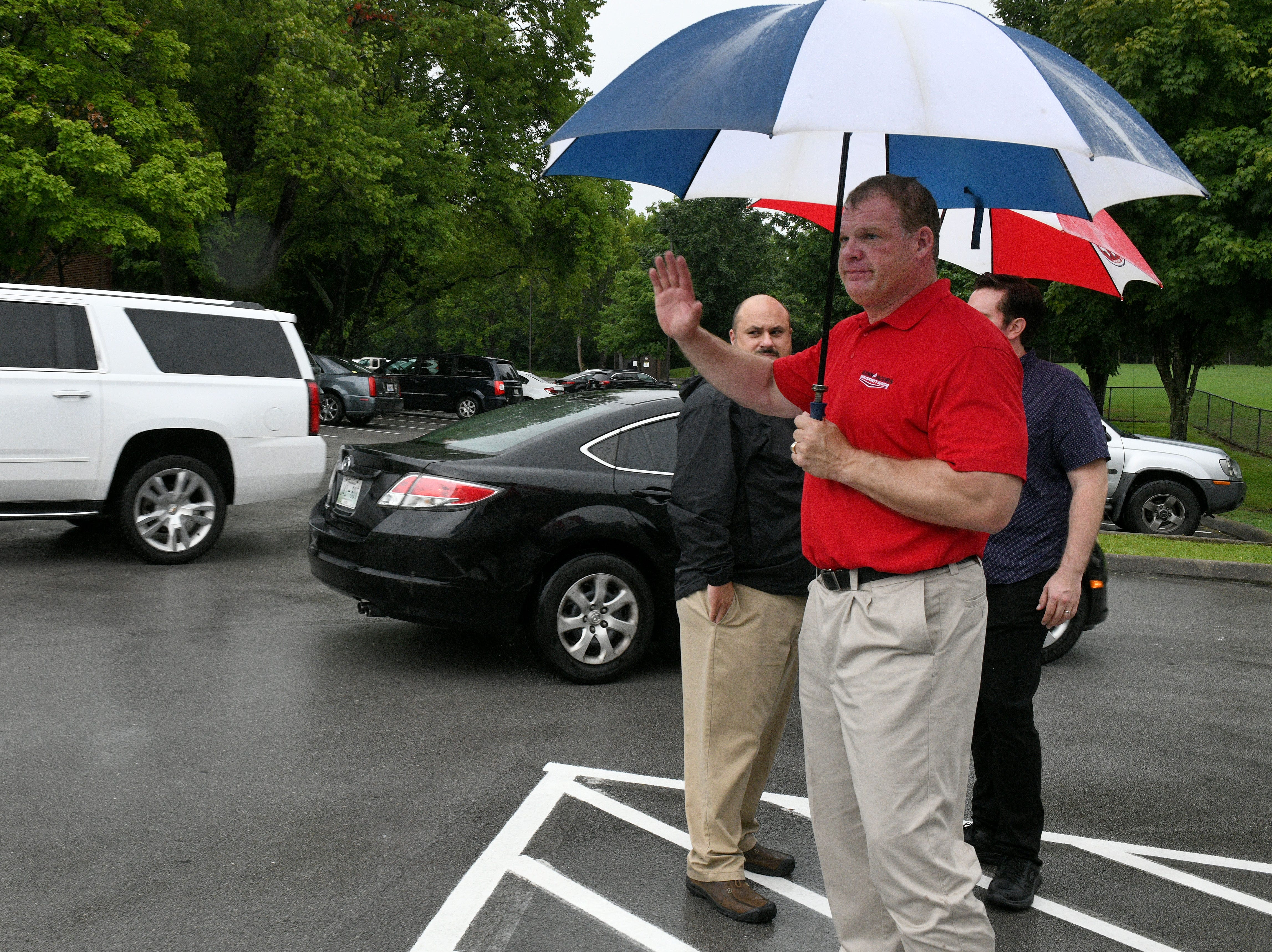 Glenn Jacobs campaigning in the rain to vote at Deane Hill Recreation Center on election day in Knox County Thursday, August 2, 2018.