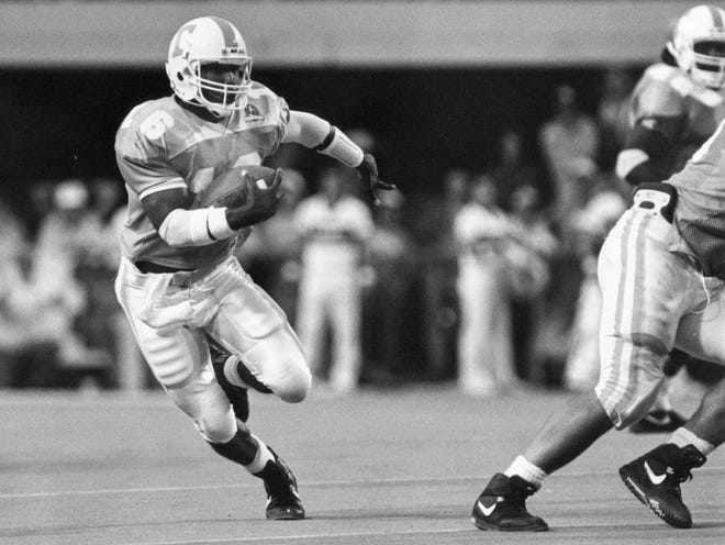 Tennessee's Sterling Henton runs for a first down against Alabama in 1990.