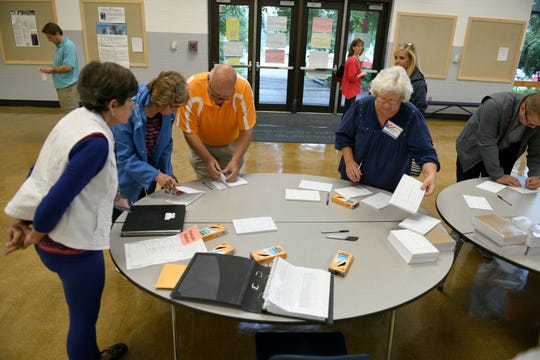 Voters fill out their cards waiting on the polls to open at Farragut 66 South on election day in Knox County Thursday, August 2, 2018.
