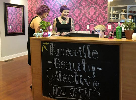 Knoxville Beauty Collective owner, Scarlet Strange, looks over the schedule with colorist/stylist Sarabeth Prindville (left) and Melody McMahan, office manager/gate keeper in the Fountain City Salon on Aug. 1, 2018.