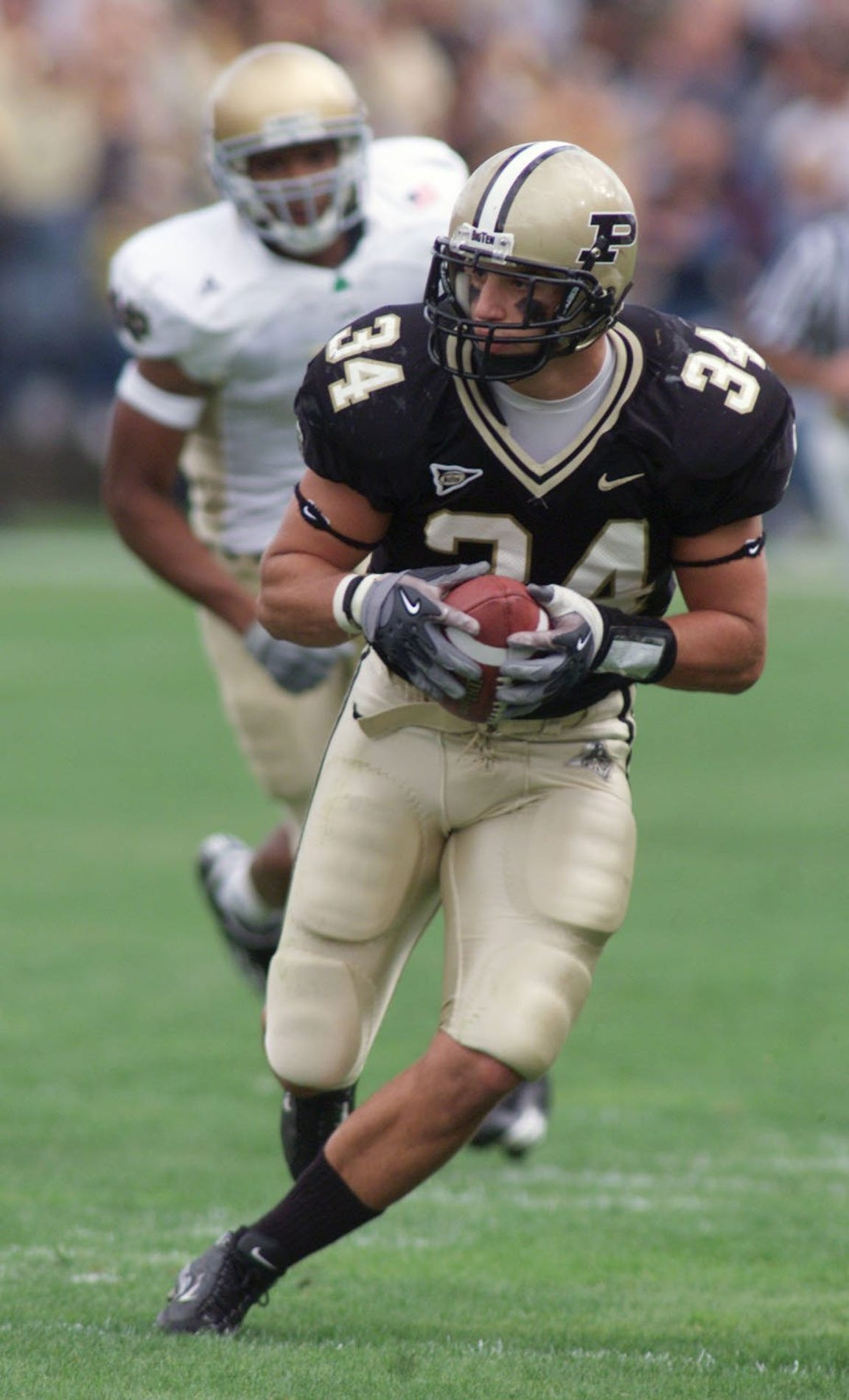Purdue linebacker Niko Koutouvides returns an interception against Notre Dame during a 23-10 vjctory in 2003.
