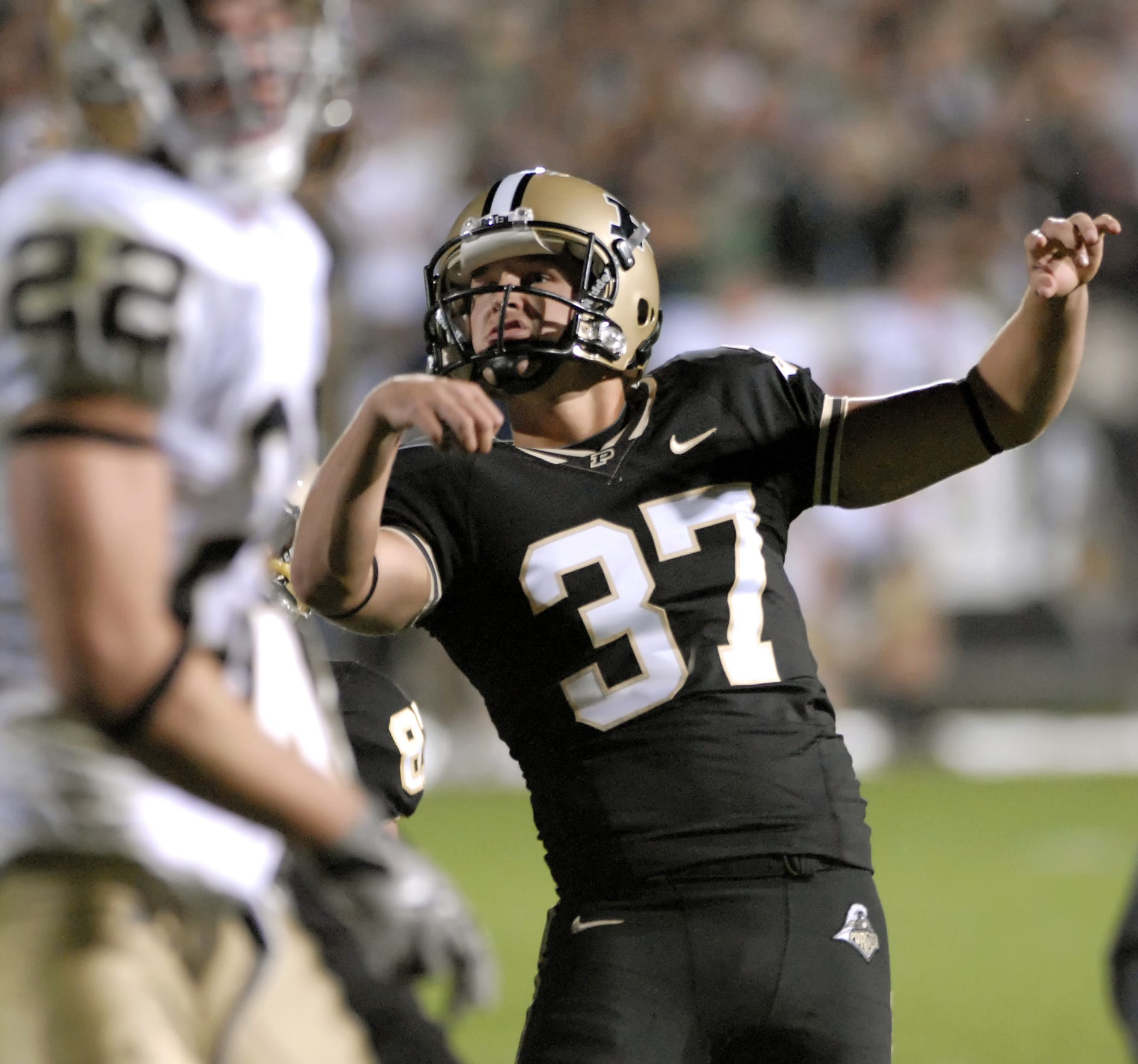Purdue kicker Carson Wiggs (37) follows through on an extra point attempt against Notre Dame during the second half at Ross-Ade Stadium in West Lafayette on Saturday, September 26, 2009.